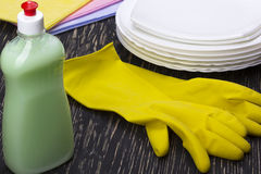 Detergent, rags dishes and latex gloves Royalty Free Stock Photos