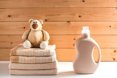 Detergent`s bottle sitting on pile of towels. royalty free stock image