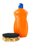 Detergent and sponge. Detergent in orange plastic bottle and sponge on isolated background royalty free stock photos