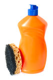 Detergent and sponge. Detergent in orange plastic bottle and sponge on isolated background royalty free stock images