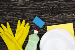 Detergent,sponge, dishes, rag and latex gloves Stock Image
