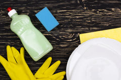 Detergent,sponge, dishes, rag and latex gloves Royalty Free Stock Photo