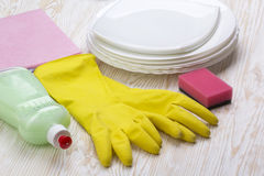Detergent,sponge, dishes, rag and latex gloves Stock Photo