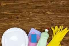 Detergent,sponge, dishes, rags and latex gloves Stock Photos