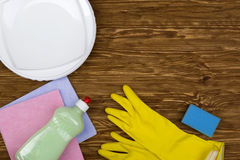 Detergent,sponge, dishes, rags and latex gloves Royalty Free Stock Image