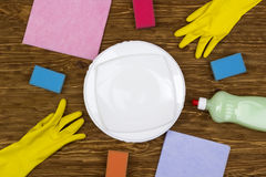 Detergent,sponges, dishes, rags and latex gloves Royalty Free Stock Image