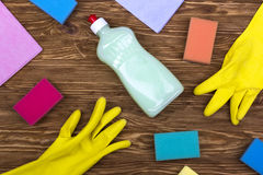 Detergent,sponges, rags and latex gloves Royalty Free Stock Photography