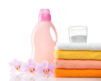 Detergent for washing machine in laundry with towels Royalty Free Stock Images
