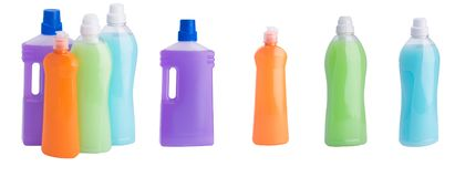Detergents and cleaning products in bottles of different shapes and colors isolated on white stock image