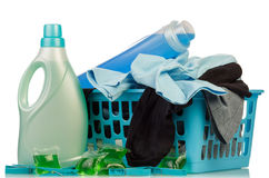 Detergents and clothes in baske. Detergents with washing powder and clothes in basket on pale background Stock Photography