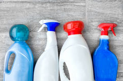 Detergents, fabric softeners and liquid doser scoop for washing Stock Images