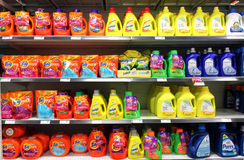 Detergents in supermarket. Different types of detergents on shelves in a supermarket Royalty Free Stock Images