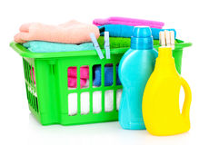 Detergents and towels in basket isolated. On white Stock Photos