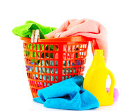 Detergents and towels in basket isolated. On white Stock Photography