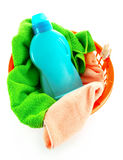 Detergents and towels in basket isolated Royalty Free Stock Image