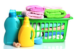 Detergents and towels in green plastic basket. Over the white Royalty Free Stock Photos