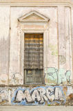 Deteriorated facade. And graffiti on the wall royalty free stock photos