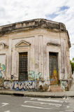 Deteriorated facade. Deteriorated traditional facade and graffiti on the wall stock photography