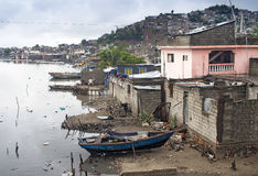 Deteriorated Houses by River, Haiti Royalty Free Stock Images