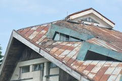 Deteriorated roof detail. Abandoned and deteriorated brick house detail stock image