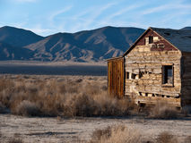 Deteriorating homestead in the Northern Nevada des. Old forgotten homestead weathering away in the Nevada desert Stock Image