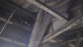 Deteriorating Wooden Ceiling filled with Spider Webs stock video footage