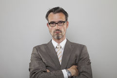 Determinated business man. Decisionmaker with crossed arms is strictly looking stock images