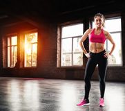 Determinated girl at the gym ready to start fitness lesson stock photography