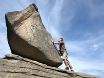 Determination. Young man against the rock Royalty Free Stock Image