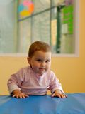 Determination Pure. An infant girl in a gym - a lot of determination in her face Stock Photos