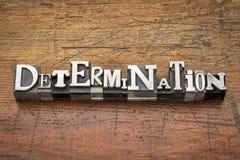 Determination word in metal type. Determination word in mixed vintage metal type printing blocks over grunge wood stock images