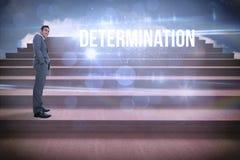 Determinazione contro i punti contro cielo blu Immagine Stock
