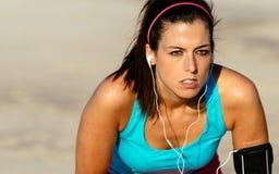 Determinazione femminile del corridore su addestramento Fotografie Stock