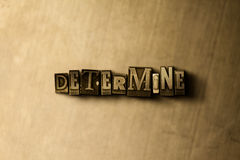 DETERMINE - close-up of grungy vintage typeset word on metal backdrop Stock Photo