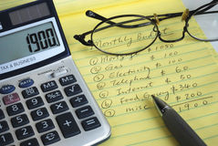 Determine the monthly budget for our home. Calculate the monthly budget for our home Stock Photos