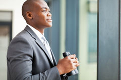Determined african businessman. Determined african american businessman with binoculars Royalty Free Stock Photo