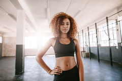Determined african female standing in the gym Stock Images