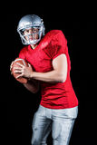 Determined American football player holding ball Royalty Free Stock Images