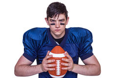 Determined american football player holding a ball Royalty Free Stock Photography