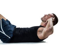 Determined athlete doing crunches Stock Photos