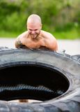 Determined Athlete Flipping Truck Tire Stock Photos