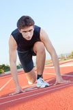 Determined an athlete is ready to start Stock Photo