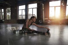Athletic girl does stretching exercises at the gym. Double exposure. Determined athletic girl does stretching exercises at the gym. Double exposure stock photos