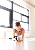 Determined Ballerina Exercising Inside the Studio Stock Image