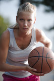 Determined basketball player. Basketball player ready to pass the ball Royalty Free Stock Photos