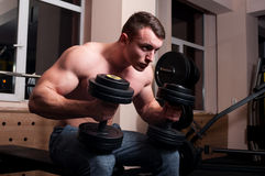 Determined body builder in the gym Stock Photography