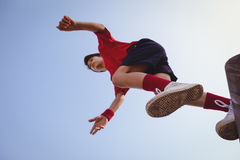 Determined boy jumping over obstacle. In boot camp royalty free stock photo