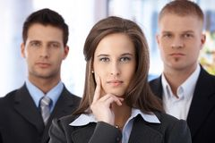 Determined business team. Portrait of determined business team, focus on attractive businesswoman Stock Photos