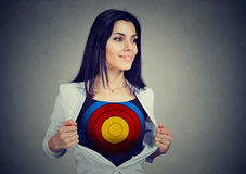 Determined business woman showing a target under her shirt Stock Photo