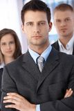 Determined businessman with coworkers Stock Photos